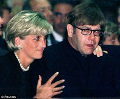 Princess Diana comforting Sir Elton John at Gianni Versace's funeral at the Milan Cathedral shortly before her own death.