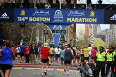 Cross the line, welcome to the club: Boston Marathon Finishers. Congratulations. Images from 114th Boston by Raymond Britt. For more see Complete coverage at www.RaceBoston.com