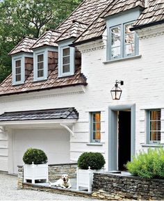 French Country Home - love the white & light blue colors with dark roof!