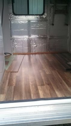 Glueless vinyl flooring laid over existing carpet, then