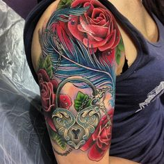 I absolutely love this by @amy_kinsell_tattoos. Roses...jeweled lock and key..feather tattoo