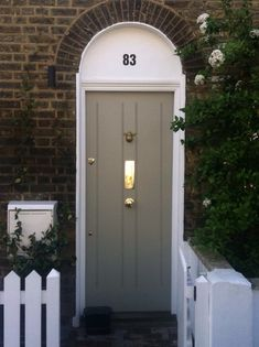 Check out this beautiful solid front door sporting flush panels with cute bumble bee knocker!