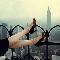 'High Heel Over Manhattan, November 1950.' + ' Woman wearing pale beige nylons by Gotham and two-color pump by Mademoiselle' Photo by Edward Kasper.