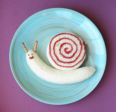 banana + peanut butter sandwich snail | 19 Easy And Adorable Animal Snacks To Make With Kids via @BuzzFeed Food
