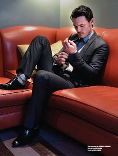 Luke Evans fiddling with his cuff links