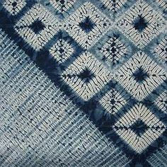 Shibori art textiles dyed in indigo
