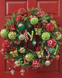 "The Primitive Pinecone staff LOVES this fully ""DECKED-OUT"" wreath which provides a FESTIVE greeting to all of your front door guests!"