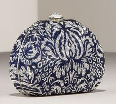 I would love this navy damask curved clutch by Judith Leiber as my wallet-- that way I can pull it out of my day bag, throw in some lipstick, and go out on the town!