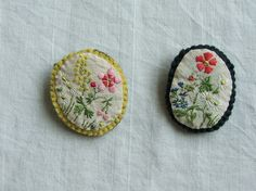 embroidered ovals would be nice to do something similar with lavendar or cloves inside and on a necklace maybe