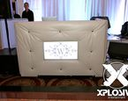 Beautiful tufted booth with in-laid TV takes the DJ booth experience to another level. #XplosiveEntertainment, #whiteDJtuftedbooth, #partyentertainment, #elevatedenhancements.