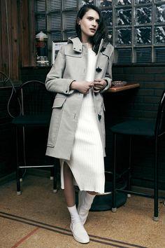 Liking the sporty coat with midi side split dress and slip-on sneakers. I'd leave off the socks. Rag & Bone Resort 2015.