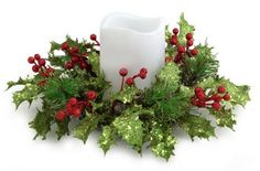 Artificial candle rings feature glitzy green holly accented with vibrant glittered red berries Each fits diameter pillar candle (not included) Dim 31489851