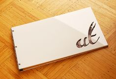 Custom white acrylic portfolio book with cut-out treatment by kloportfolios.com