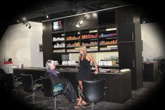 Double sided color bar with flatscreens that show fashion shows, how-to videos, salon events and more.
