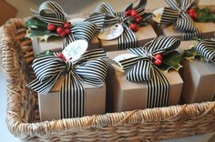 Charming way to wrap presents large or small. Cardboard box or brown paper, jolly striped ribbon, holly berries with leaves plus a tag for a stylish, contemporary look.