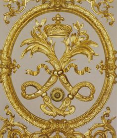 """Versailles~ wall panelling with carved and gilded medallion with interlaced letter """"L"""" the Royal Monogram of Louis XIV, King of France."""