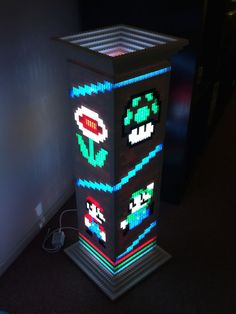 Give the game room some great ambient lighting with the LEGO Super Mario Bros lamp. This retro LEGO lamp features an old school graphic depicting the famous Italian plumbers heroically chasing after a mushroom and flower on their quest to power up. Lego Super Mario, Super Mario Bros, Lego Mario, Legos, Lego Lego, Video Game Art, Video Games, Deco Gamer, Diy Canvas Art