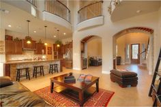 Spacious living room with tile floor and Juliette balconies 105 Shorthorn St