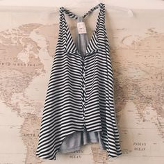 Striped top Black and white stripes with satin feel in front and gray cotton material on back. ❌NO TRADES❌ PRICE FIRM UNLESS BUNDLED❌ Tops