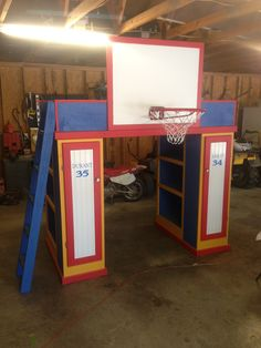 Loft bed with 2 bookcases 2 lockers ladder and basketball goal all painted in OKC Thunder colors and little boys name on one locker Nd his favorite player on the other