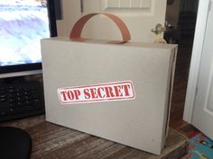 Cereal box turned inside out to make briefcase. Construction paper handle. For Agency d3 VBS.