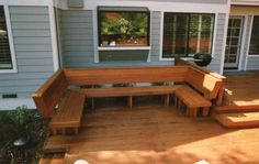 A redwood bench with backs built in a U shape for wonderful area for friend and laughter.