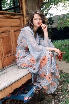 Charlotte Rampling in Glamour magazine, vintage fashion style color photo print ad sheer long maxi gown boho blue orange flowers flowing hostess dress Charlotte Rampling, Moda Hippie, Moda Boho, 70s Hippie, Hippie Style, Retro Mode, Mode Vintage, Vintage Style, Vintage 70s