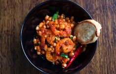 Spicy Garlic Shrimp and White Beans - Here's what you should make for a dinner that feels special. Shrimp pairs perfectly with white beans and tomatoes for a spicy comfort-food classic. Ingredients...