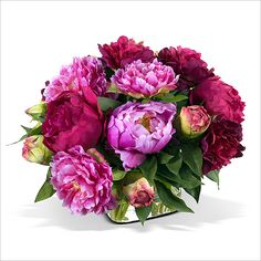 Peony Bouquet: Peony BouquetBeautiful artificial Peony flowers and buds in rich, varied shades of fuchsia combine with lush foliage in a lovely bouquet. Placed into our 5 inch glass cube vase with permanent acrylic, 12 inches height.