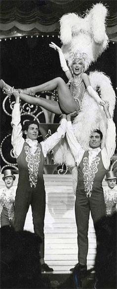 Carol Channing as a showgirl performing in Las Vegas with her showguys -  vintage / old photo.