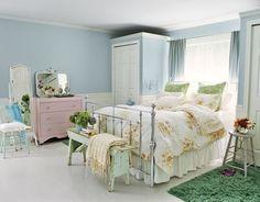 Blue master bedroom except for the pink dresser...