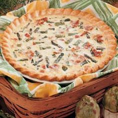 Asparagus Bacon Quiche. I made this tonight for dinner, but I added a chopped tomato and substituted half of the parmesan cheese for swiss. Yummy.