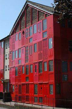 Red house with salvaged doors in Liverpool #Architecture, #Door, #Repurposed