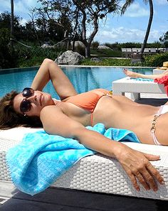 One day after unretouched photos of her body were leaked, Cindy Crawford looked fit and slimmer than ever in new bikini pics shared by her husband Rande Gerber on Valentine's Day via Instagram