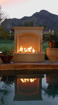 Firepit beside pool - the reflection casts a nice light, too!  Doubles the ambience!