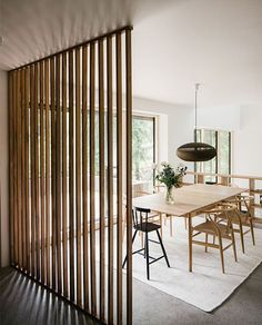 Wooden partitions are a great way to separate rooms in tiny spaces.  I like the natural warm look about this room - pendant is perfect