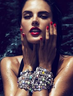 Alessandra Ambrosioin red lipstick with matching red nails. #celebstylewed #bridal #nuptials