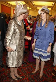Camilla Parker Bowles & Princess Beatrice... this is a masquerade party right?  These look like costumes, really.