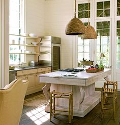 Basket Case: The pendant lights above this kitchen island are made from woven baskets, which add a relaxed cottage feel to this workspace. Decorating with natural fibers is an easy trick for making a room feel comfortable.