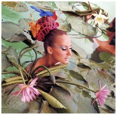 Tahiti Lilies, Brigitte Bauer wearing ribbon and butterfly chignon by Adolfo, arranged here by Kenneth, Vogue May 1965