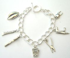 DeNTaL-ChArMs-BrACeLeT-DeNTiST-TooTHPaSTe-TooTHBRuSH-FLoSS-TooTH-iN-GiFT-BaG