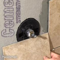 the family handyman editor, jeff gorton, shows you how to layout the hole and ho. - the family handyman editor, jeff gorton, shows you how to layout the hole and how to cut it with an - Tuile, Shower Pan, Diy Home Repair, Home Improvement Loans, Tile Projects, Shower Valve, Tile Installation, Shower Remodel, Bath Remodel
