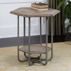 This hexagonal wood accent table features two levels of storage in a light tan chippy paint finish that brings out the natural fir grain. Add a unique, earthy appearance to any room with this Mayson table.
