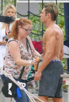 A woman was spotted touching up Zac Efron's abs on the set of the 'Baywatch' remake on Sunday, March 6 — see the sexy snaps