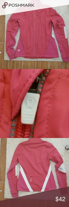 🍋LULULEMON🍋 Jogger/Cycling Jacket Size 6 Gently Used light Vintage Lululemon jogger/cycling  reflective jacket, Size 6, Salmon color, *some wear on both inner elbows pic above discloses*  2 front pockets and one larger back pocket, Inside has 2 adjustable drawstrings and mesh inset, with pull thumbholes. No holes, tears or stains. All zippers are functional  🎆Bundle with other Yoga or Athletic gear to receive 10% off and discounted shipping🎆 lululemon athletica Jackets & Coats