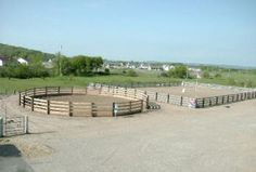 this is the way I'd like a round pen- right up next to the larger arena so young riders and young horses could graduate into the bigger area without drama.