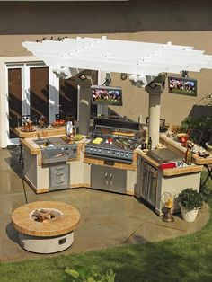 25 Amazing OutdoorKitchens - Style Estate - Umm.. Whoa!! I would like a little more bar space, but still pretty awesome with the tv's and all