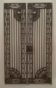 Pair Of French Art Deco Wrought Iron Gates   From a unique collection of antique and modern doors and gates at https://www.1stdibs.com/furniture/building-garden/doors-gates/