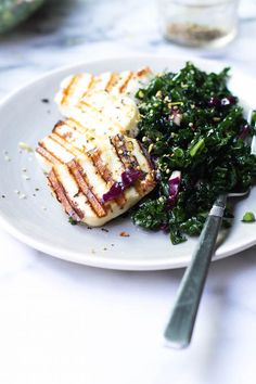 Grilled Halloumi Cheese and Kale Salad // Halloumi makes a buttery, indulgent addition to a simple kale salad! Awesome, meat-free way to dress up your salad plate.