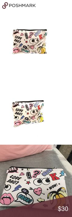 NWT NEVER USED Fun Emoji Purse Fun Vegan leather emoji cross body bag!  Perfect for the girl on your list!    Zip top closure.  Removable chain strap.  Could also be used as a make-up or small toiletry bag. Accessories Bags